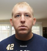 Officer Darren Wilson in an undated photo released by the St Louis County Prosecutor's Office.