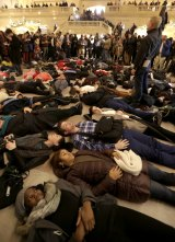 "Protesters stage a ""die-in"" at New York's Grand Central Station after the Garner decision was announced."