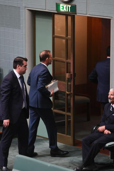 Tony Abbott and Michael Sukkar leave the chamber on Thursday before the final vote.
