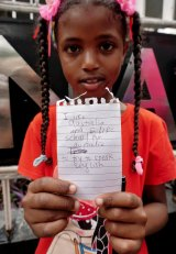 Samar, 8, an asylum seeker from Sudan at the protest outside the UNHCR in Jakarta on Monday.