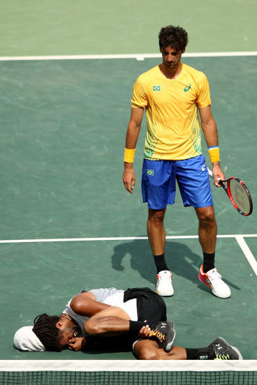 Thomaz Bellucci stands over his stricken opponent, Dustin Brown of Germany.