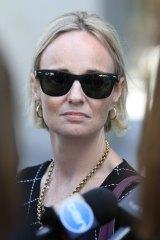 Robyn leaves the Brisbane District Court after her former partner was jailed.