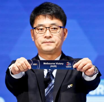 Asian Football Confederation director Shin Mangil draws Melbourne Victory's name.