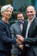 IMF managing director Christine Lagarde, left, greets Greek Finance Minister Yanis Varoufakis on Thursday.