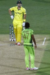 Wahab Riaz has words with Shane Watson during the quarter-final in Adelaide.