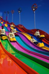 Children ride down the slide at the 2012 Easter Show.