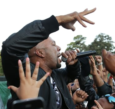 Crowd-pleaser: Rapper Common takes it to the fans.