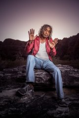 """Bart Willoughby poses for a photoshoot in front of the """"bee-hives"""" in the Bungle Bungles, Purnululu National Park."""