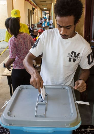 A man casts his vote in East Timor's parliamentary elections on Saturday.