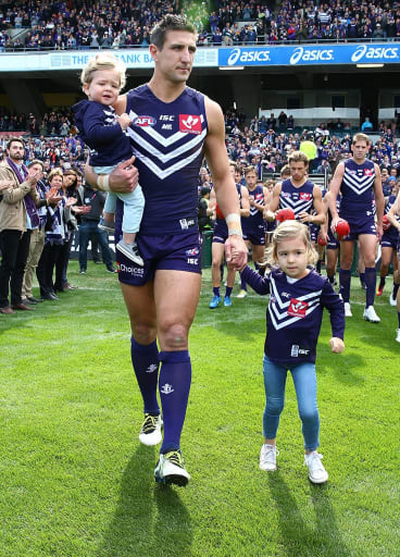 Leading light: Matthew Pavlich leads team onto the field with his children Jack and Harper, before playing final game for the Dockers.