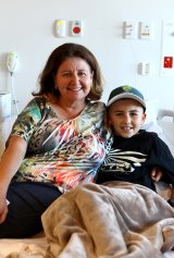 Twelve-year-old Bryson Morrison, who is battling Leukaemia, with his mum Rosa Morrison, was one of the many patients transferred from the Royal Children's Hospital in Herston to the new Lady Cilento Children's Hospital at South Brisbane.