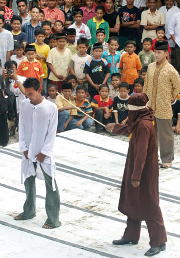 Aceh is the only one of Indonesia's 34 provinces where sharia-inspired punishments are on the statute book. This man is being caned for gambling in December 2005.