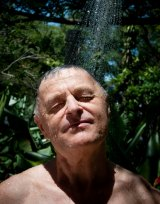 Tony Olejnicki cooling down with a shower in New Farm.