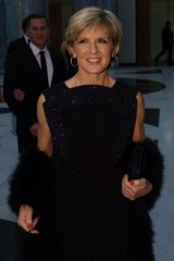 Grand entrance: Julie Bishop arrives at the Midwinter Ball at Parliament House in Canberra in June.