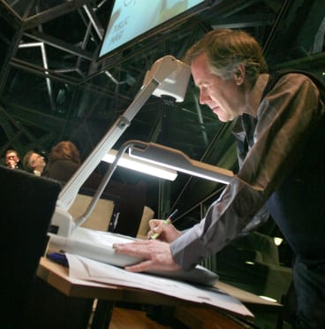 Master at work: Ron Tandberg doing his cartoons to a live audience at BMW Edge for <i>The Age</i> Conversation Series.