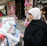 A Palestinian woman reads about the Israeli election result in Gaza.