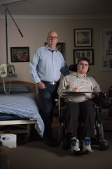 Josh has a degenerative muscular disease which means he needs a carer to attend to his every need. Josh is pictured with his father Rick.