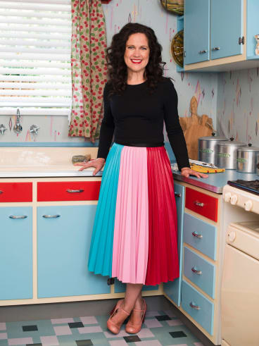 Annabel Crabb looks right at home in the Ferrones' 1950s kitchen.