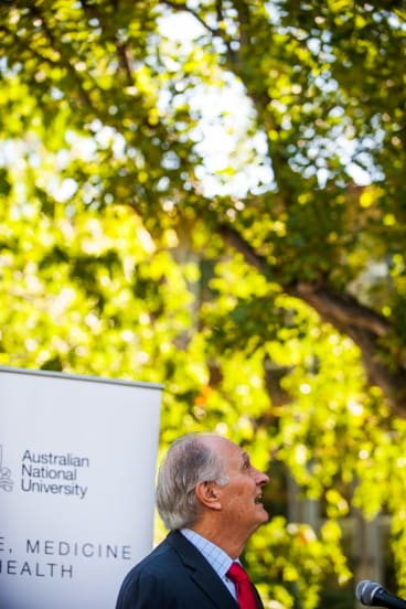 Professor Alan Alda, competes with a cockatoo during his speech at the official opening of the Alan Alda Centre at The Australian National Centre for the Public Awareness of Science (CPAS) at the ANU.