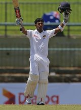 Ton up: Kusal Mendis celebrates scoring his maiden Test century on day three of the first Test.