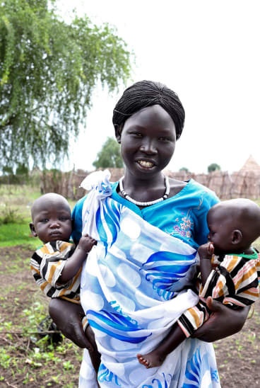 Nyabang Lul, 23, brings her twin daughters Nyajuok and Nyatut, right,   to be screened for malnutrition at The Save the Children feeding centre in Denjuok, South Sudan, last year.