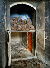 Peat in a kiln creates heat and smoke that gives the barley its distinctive, polarising flavour.