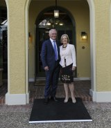 Settling in well: Prime Minister Malcolm Turnbull and his wife Lucy arrive at the Prime Minister's Lodge for their first night.