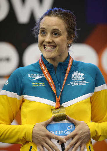 Ellie Cole poses with her gold medal.