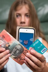 Danika Klinkenberg gets her pocket money paid straight into a credit card linked with an app.