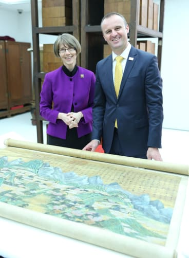 Chief Minister Andrew Barr and National Library of Australia director-general Anne-Marie Schwirtlich with one of the works.