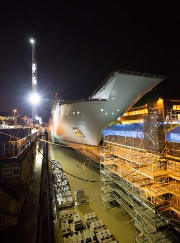 HMAS Adelaide enters the dry dock for examination.