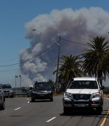 The view across Sutherland Shire from Captain Cook Bridge towards a fire in the Royal National Park.