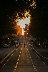 The sun shines on Collins Street.