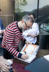Massimo Bottura signed books and chef coats at the event.