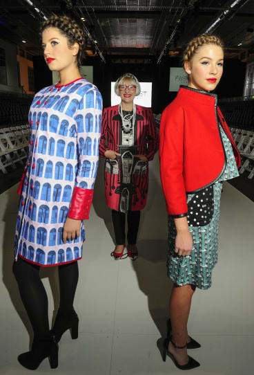 Fashion designer Mariska Thynne on the runway with models Emily Tokic, of O'Malley, and Angelina Leljak, of Gungahlin.