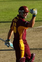 Peter Forrest of the Bulls celebrates victory after hitting the winning runs.