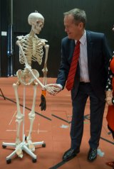 Mr Shorten leant over the science prop, shaking the bony character's hand, laughing.