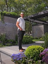 Brent Reid with his Metropolis garden, laid out like the grid of Melbourne's CBD.