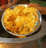A palce of chicken biryani from a street vendor in New Delhi.