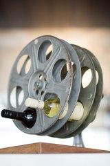 Film reels have been recycled as wine racks.