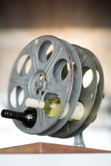 Film reels have been recycled as wine racks.