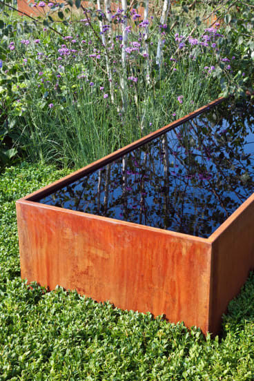 A simple raised pond creates a tranquil atmosphere and a place for contemplation.