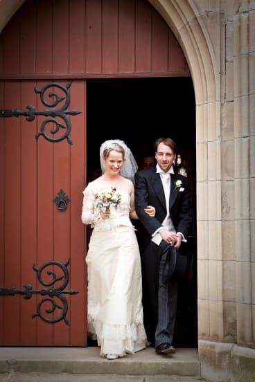 Caitlin Fitzsimmons wore a Cymbeline gown she bought on sale for her wedding in 2009.
