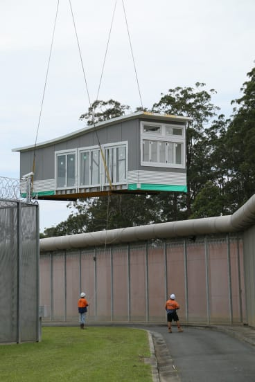 A prison block is lifted into a NSW prison after being built by inmates at St Heliers prison.
