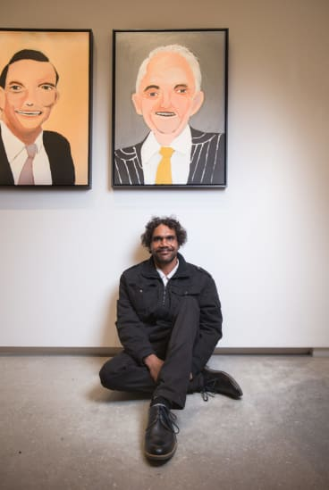 Vincent Namatjira with his portraits of Tony Abbott and Malcolm Turnbull, part of the TarraWarra Biennial.