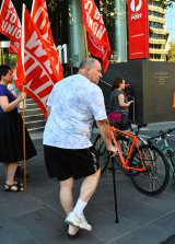 Injured worker Graeme Brown joined the protest outside the Australia Post headquarters.