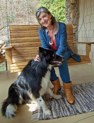 Barbara Kingsolver at home with her dog Walker.