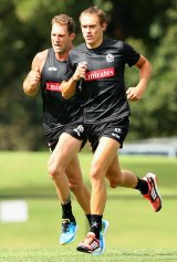 Darcy Moore training with Travis Cloke.
