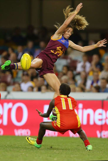 Flyin' Lion: Jenna McCormick jumps for a mark during the women's AFL exhibition match against the Gold Coast Suns at the Gabba last weekend.