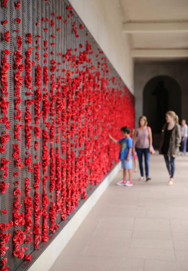 Visitors at the Roll of Honour at the Australian War Memorial.